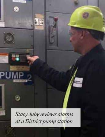 Stacy Juby reviews alarms at a District pump station.