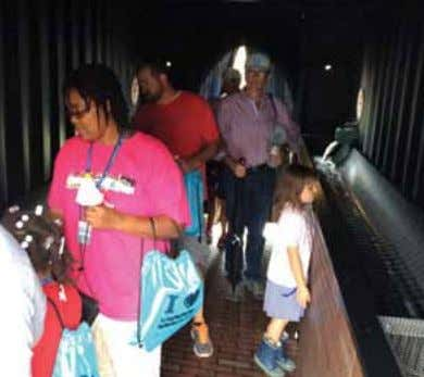 Visitors to the Sewer District's annual Open House explore the Sewer Simulator. What's it like