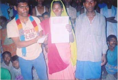Rajwatia w/o Tilakdhari receiving her mortgaged land Acquisition papers