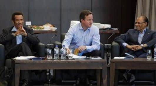 result for a Forum, according to the event's organisers. UK Prime Minister David Cameron (Middle), Mauritius