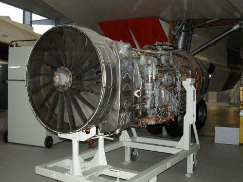 with a highly modified Pratt & Whitney TF30 left engine Rolls Royce Olympus 593 engine F-111C