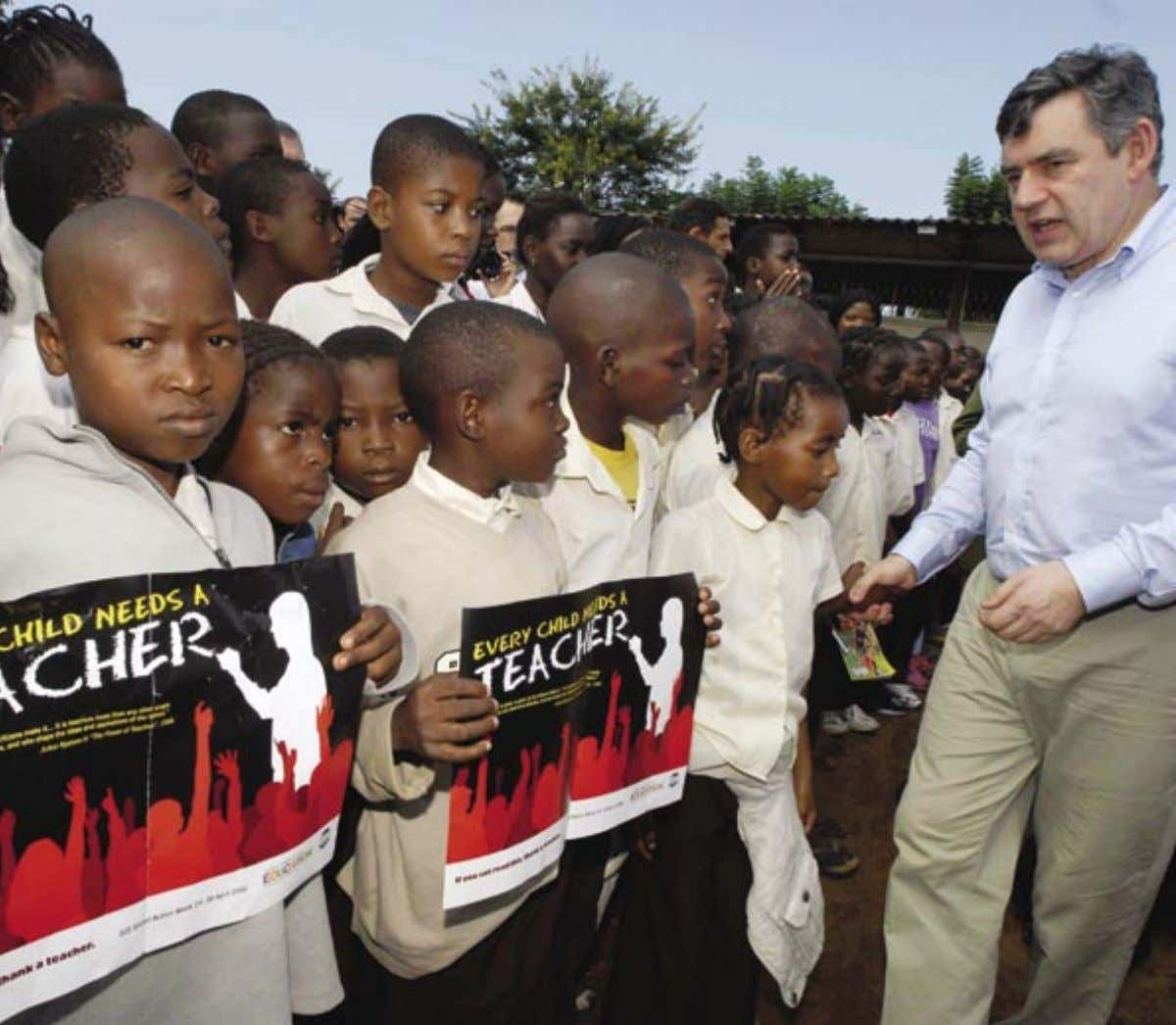 2 4 Pupils at Forces Primary School urge Gordon Brown, British Chancellor of the Exchequer, to