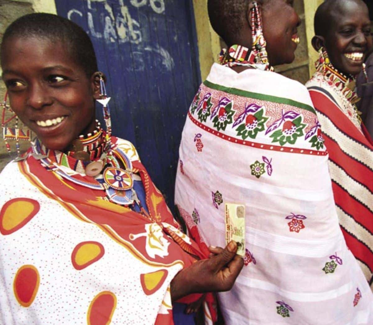 5 42 Masai women queue up outside a polling station in Kajiado district, holding their voting