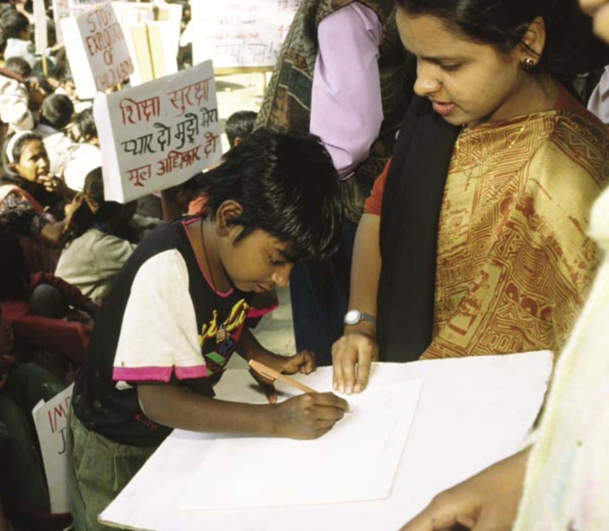 1 vi vi Children sign up to join the Bal Mazdoor children's union. Maintained by an