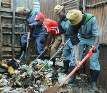 sure he delivers them in good quality. Photo: Joseph Kinyua National Youth Service (NYS) youths doing