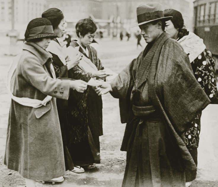 "spreading ""revolutionary ideas."" In 1916, it was banned. Suffragettes in Tokyo in 1920 spread the word"