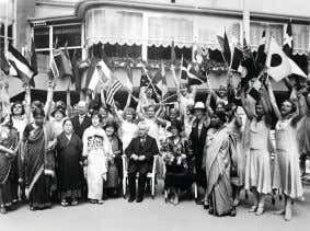 Delegates wave their national flags at a meeting of the International Council of Women in