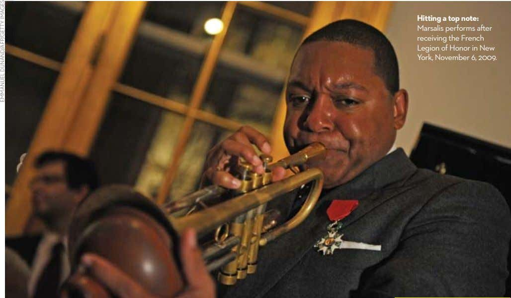 Hitting a top note: Marsalis performs after receiving the French legion of Honor in New