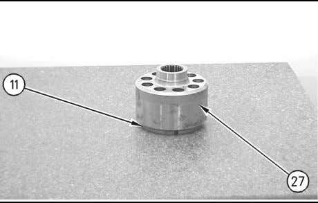The flat side of the port plate should rest on the surface plate. Illustration 54 g00875830