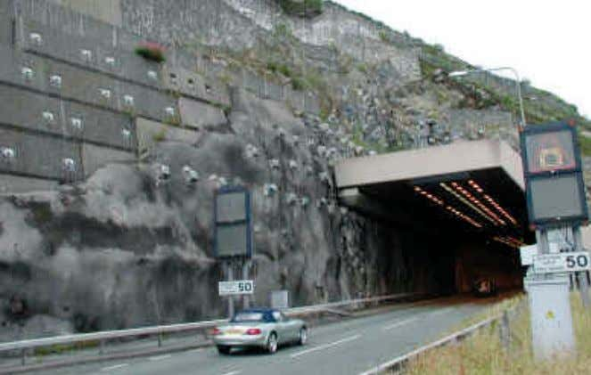 is shown in figure C20. Rock Slope Stabilization/Mitigation Figure C20. concrete retaining walls, gabion walls (both