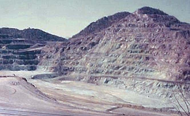 have drainage ditches to divert water away from the slope. Figure C28. photograph of a mine
