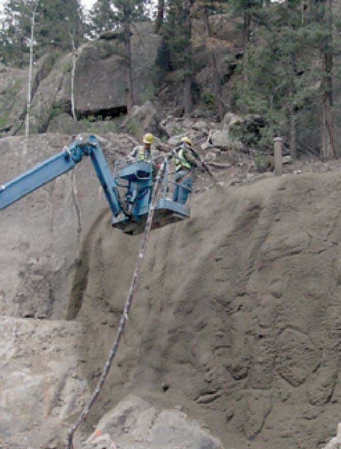 C31 shows a shotcrete operation on the side of a highway. Figure C31. Mountains of Colorado,