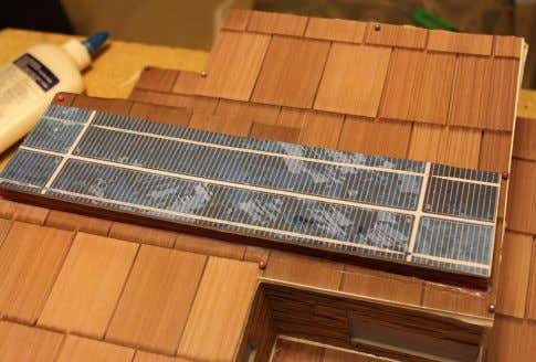 to a solar panel, it was glued on top of the design. Solar Panel: The addition