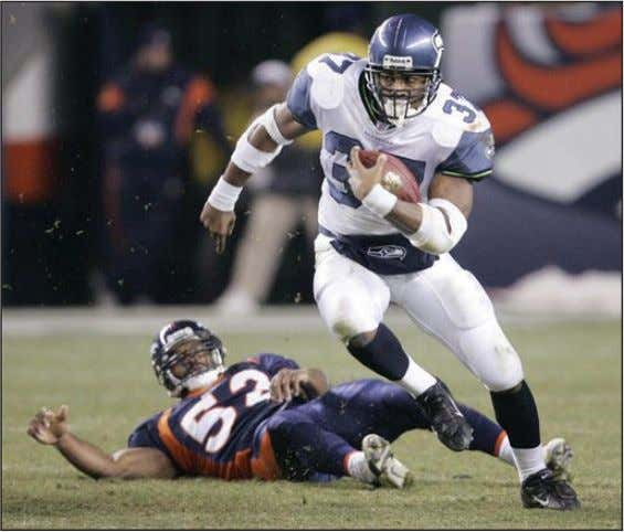 QB Seatle Seahawks Edge Denver 23-20; Broncos Slide to 7-5 Courtesy ESPN Seattle's Shaun Alexander left