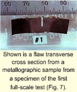 a semi-elliptical depth profile was sleeved and tested. Shown is a flaw transvers e cross section