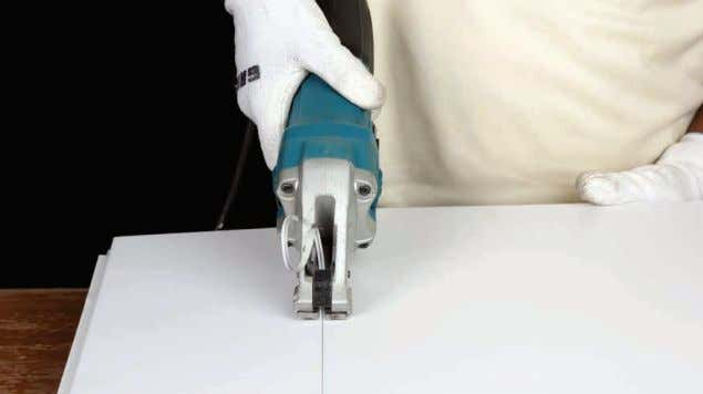• Use a shear machine to cut the face of the metal tile. TO POINT NOTE