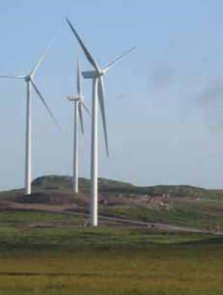"and tend to the environment in which we all live."" Figure 1.12: A large wind turbine,"