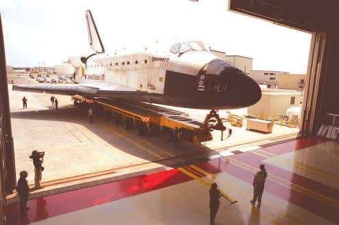Discovery rolls into the Orbiter Processing Facility where it will be processed for another flight.