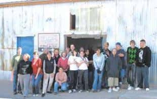 DESERT EXPOSURE DECEMBER 2011 23 Volunteers outside the Food Pantry at the Where- house. (Photo courtesy