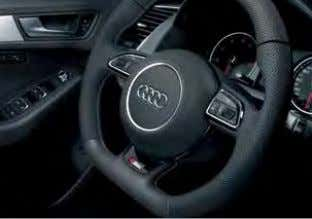 the specific acoustic properties of the car's interior 3-spoke multi-function flat-bottomed steering wheel Audi