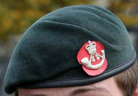 worn behind the left chin strap button. Beret. The poppy with red petal stripped is worn