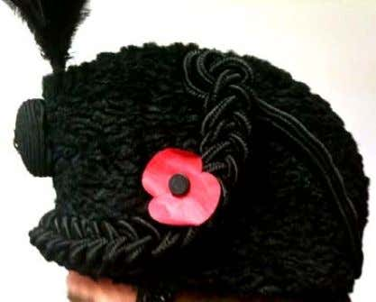 & Bugles): The poppy is worn intact with the stem pinned on the left hand side