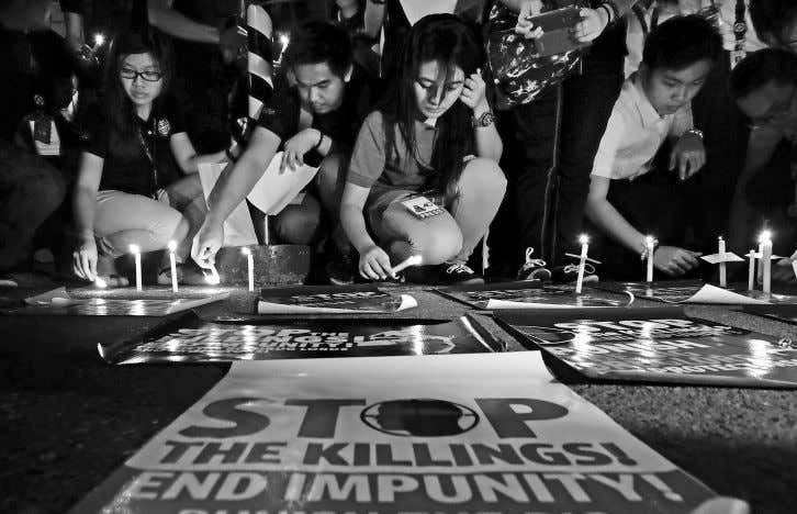 STATEMENTS Students light candles as they call for an end to extrajudicial killings around the country