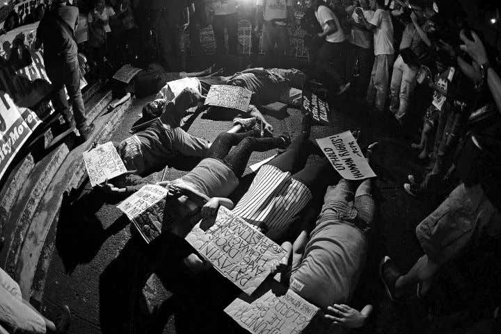 STATEMENTS Activists lie on the ground outside the Sto. Domingo Church in Quezon City to protest