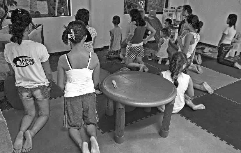 ARTICLES Girls pray at a shelter for abused women and children in Tacloban City. ROY LAGARDE