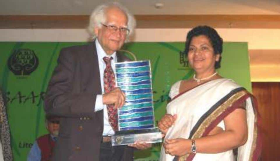 receiving the SAARC LITERARY AWARD from Dr. Abid Hussain. Dr. Abid Hussain honouring Excellency Ms. Kanthi