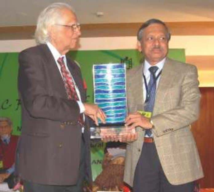 honouring Dr. Abid Hussain with SAARC LITERARY AWARD. Dr. Abid Hussain honouring Dr. Sheel Kant Sharma