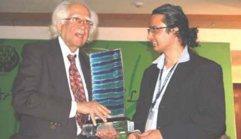 receiving the SAARC LITERARY AWARD from Dr. Abid Hussain. Dr. Abid Hussain presenting the SAARC LITERARY