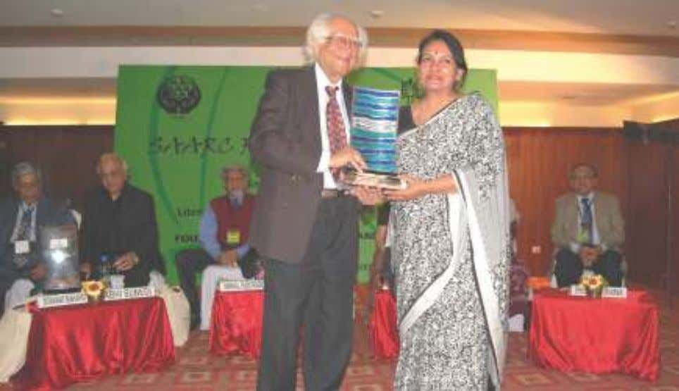 Dr. Abid Hussain presenting the SAARC LITERARY AWARD to Dr. Noor Zaheer, eminent fiction writer