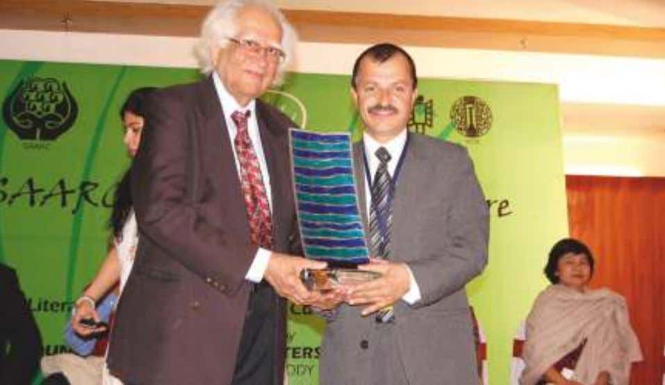 SAARC LITERARY AWARD to Mr. Ibrahim Waheed from Maldives. Dr. Abid Hussain presenting the SAARC LITERARY