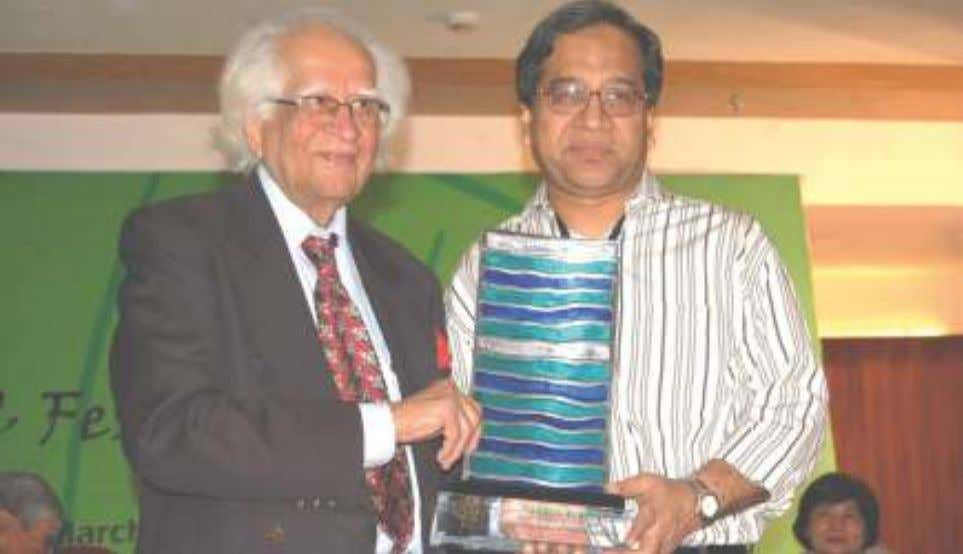 Dr. Abid Hussain presenting the SAARC LITERARY AWARD to Prof. Fakrul Alam, eminent scholar and