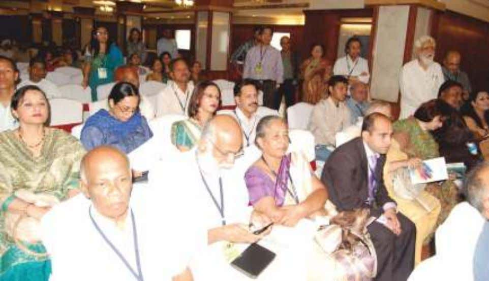 and Manmohan Singh Mitwa with Sufi Singer Mr. Iqbal Bahoo. Attentive Audience. Dr. Nihal Rodrigo and