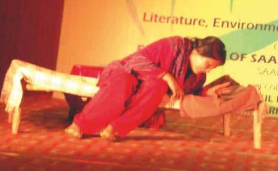 A scene from the play 'Boohe-Baariyan'. Baul Singer and dancer Parvathy Baul. The overflowing mesmerized