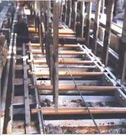 automatic dowel bar and tie bar inserters (figure 10- left). Figure 10. Positioning dowel bars by