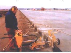 in holes drilled in the hardened concrete (figure 11-right). Figure 11. Inserting tie bars in longitudinal