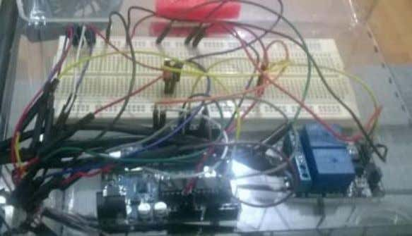  Controller system:  Arduino board; Fig 2 – Controller system currently mounted.  Automatic Watering