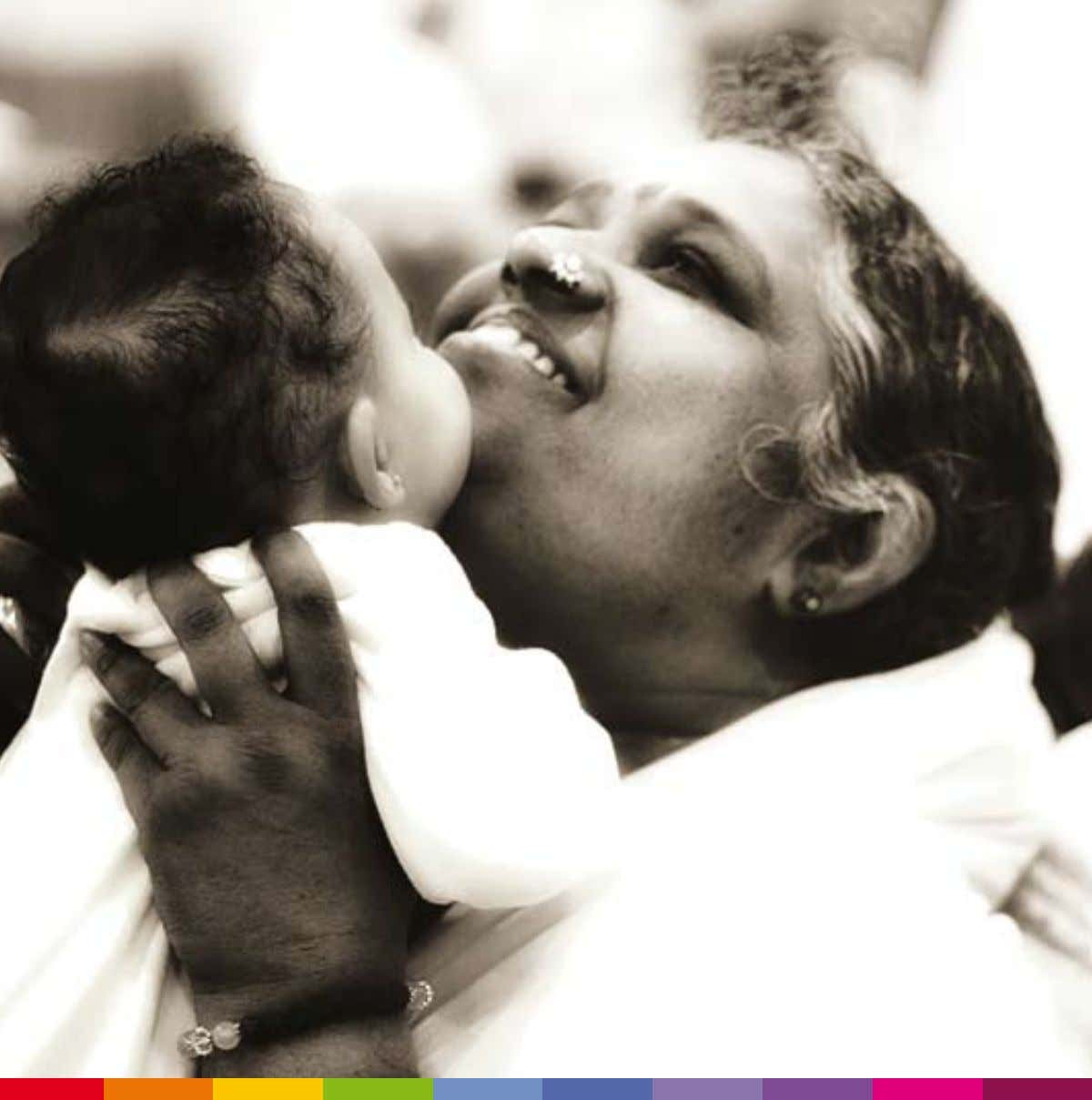 THE HUMANITARIAN ACTIVITIES OF SRI MATA AMRITANANDAMAYI embracing the world T M