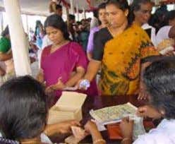 embracing the world | D ISASTER RElIEf Women training to become tailors in Kerala Distribution of