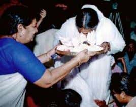 Amma blessing seeds for distribution to poor families 4 4 embracing the world | COMMUNITy OUTREACH