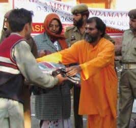 a cheque from MA Center for Hurricane Katrina relief Earthquake relief - Kashmir Flood relief -