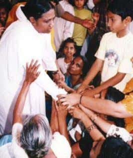 moments before the waves washed into Amritapuri Ashram Amma consoles distraught refugees at an ETW relief