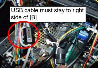 USB cable must stay to right side of [B]