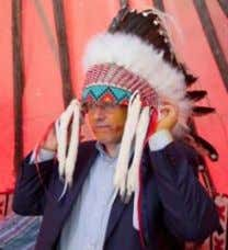 "FIRST NATIONS STRATEGIC BULLETIN Page 14 ""Chief"" Stephen Harper in a headdress given to him by"