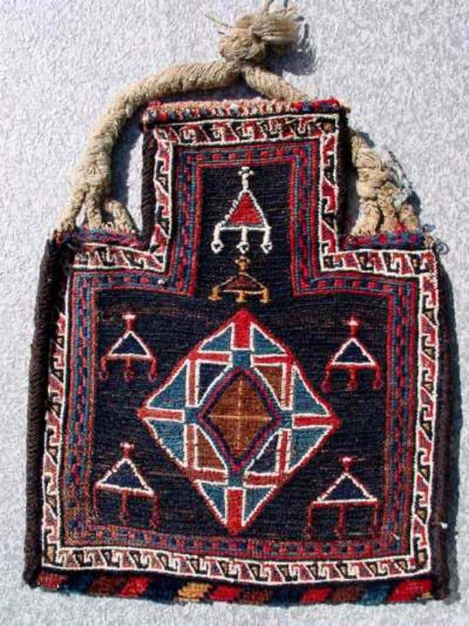 GRAPHICS OF MUSHQAH ( NAZAR ) AMULET IN TRIBAL ARTWORK The graphic pattern of Mushqah wards