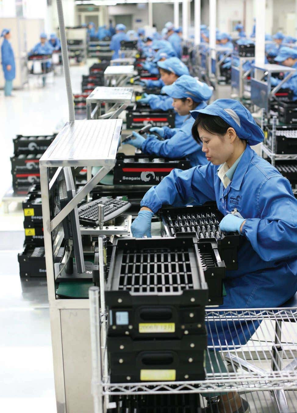 BUSY: Workers perform final testing at a Seagate factory in Wuxi, China, before sending computer