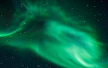 see a glimmer in the sky. At night, the light is comparable to the Northern Lights.